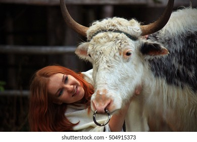 Young woman and yak