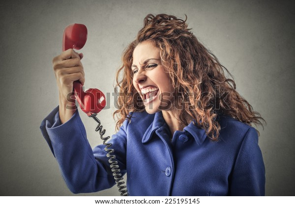 Young woman yelling at the phone