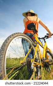 Young woman with yellow bicycle