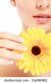 Young woman with yellow flower, isolated on white background