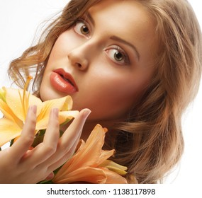 young woman with yellow lily isolated on white