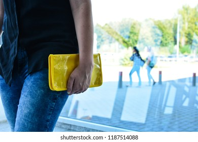 Young woman with yellow travel case, passenger in airport