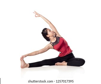 Young woman yoga doing stretching,  lotus pose; isolated on white background , with clipping path.