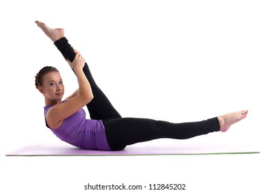Young woman yoga instructor doing split isolated