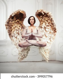 Young woman yoga levitation and meditation concept. Objects flying in room.