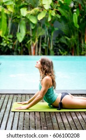 Young woman in yoga pose training outdoors