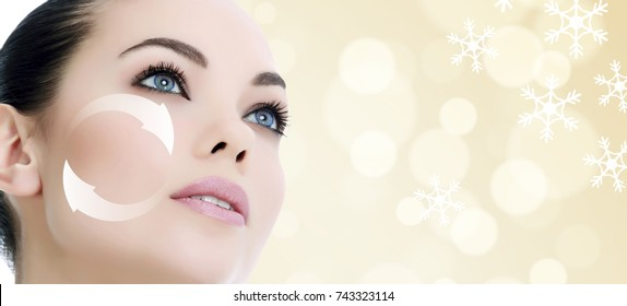 Young woman's face, antiaging concept, abstract background with snowflakes