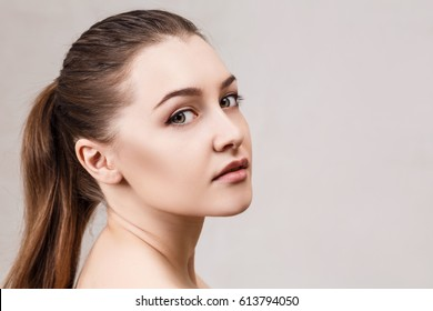Young woman's face with clean skin.