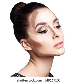 Young woman's face with contouring makeup.