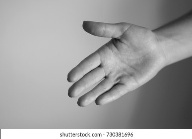 Young woman's hand calls to follow her. Gesture