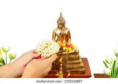 Young woman's hand respect Budda image by Jasmine garland  on Songkran festival with clipping path