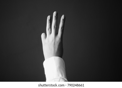 Young Woman's Hand. Three Fingers Gesture.