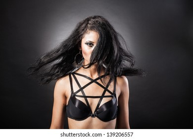 Young Woman's Long black Hair in Motion on a black background