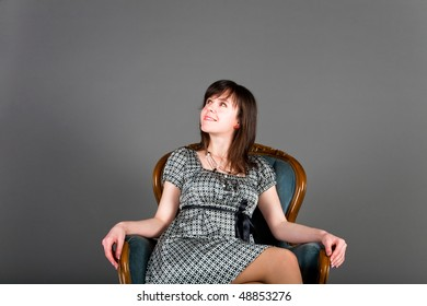 young women in armchair sees something interesting
