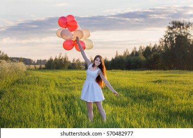 young women with balloons outdoor