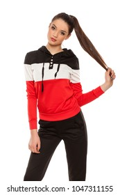 young women in black and red tracksuits on a white background