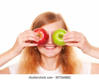 Young women closing her eyes two red and green apples. Isolated on white background