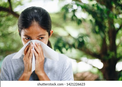 Young women coughing and covering mouth with a tissue , take care of your Health concept , Health care concept