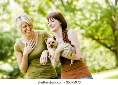 Young women with dog walking in a park