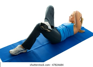 Young women doing crunches on fitness mat. Isolated on white