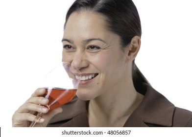 Young women is drinking wine and is very happy has a large smile.