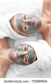 Young women with facial masks in spa salon
