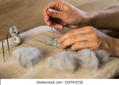 Young women felting a koala bear, handmade and crafts, wool felting animal