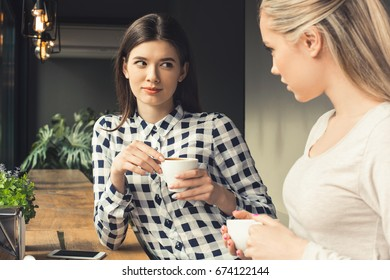 Young women friends in a coffee shop free time