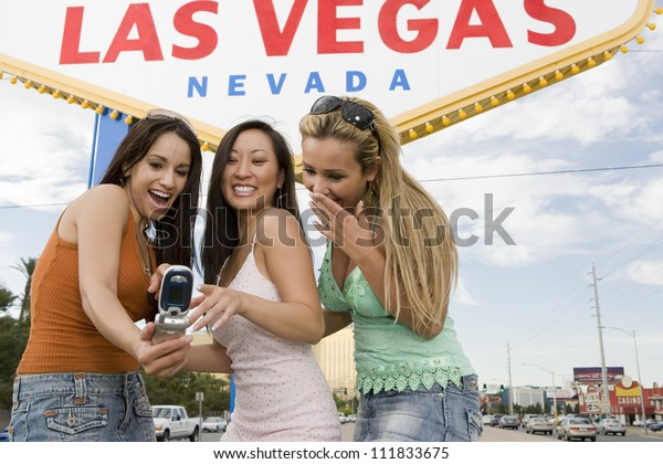 Young women in front of a 'Welcome to Las Vegas' sign