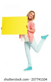 Young women with funky yellow sign