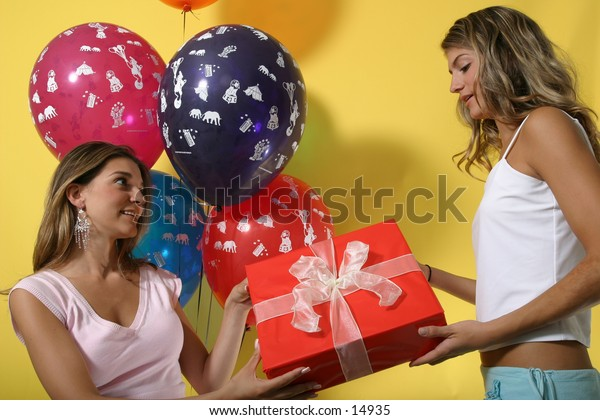 young women with gift and balloons