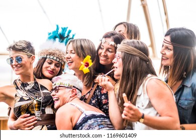 young women and girls in friendship all together celebrating and having fun in a bio natural place. smiles and laughing for group of hippies people alternative concept lifestyle. hipster youthful