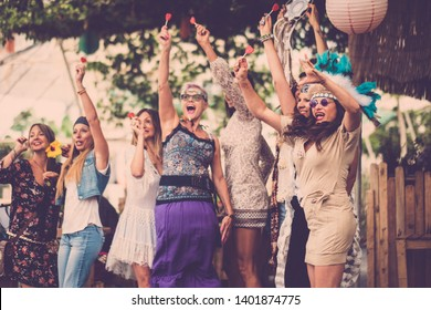 young women and girls in friendship all together celebrating and having fun in a bio natural place. smiles and laughing for group of hippies people alternative concept lifestyle