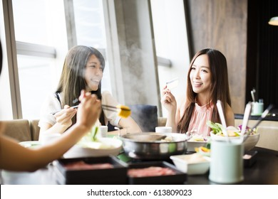 young Women group  Eating hot pot and showing credit card