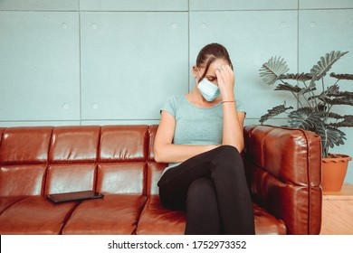 Young women have stress and anxiety after the coronary epidemic, or covid-19, due to being detained and worsening their new lifestyle and business. Depression and mental illness. Social distancing.