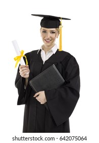 Young women in her graduation gown; isolated on white background
