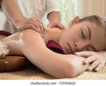 Young women laying face down on the bed for oil spa and massage, massage is for pain relief and relaxing