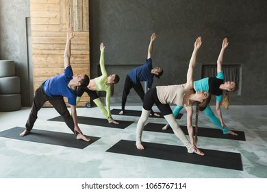 Young Women And Men In Yoga Class Stretching Balance Exercises Healthy Lifestyle