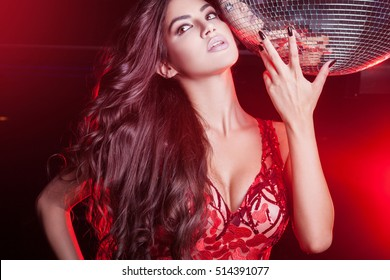 Young women at the night club in red dress