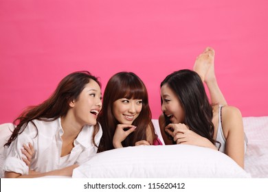 Young women on bed and isolated on pure background