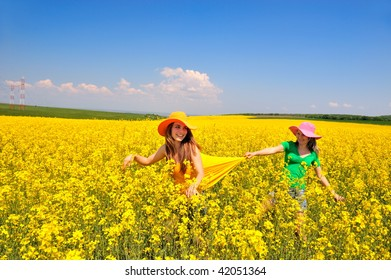 young women on field in summer