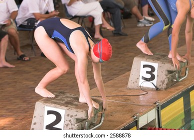 Young women on starting block awaitings starters orders