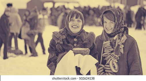 Young women with pancake during  Shrovetide at Russia