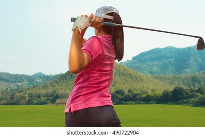 Young women player golf swing hit shot on course in summer