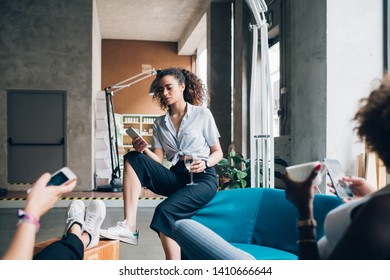 Young women playing with smartphone and relaxing –   interaction, cheerful, togetherness