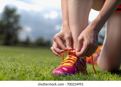Young women is preparing to run, training concept