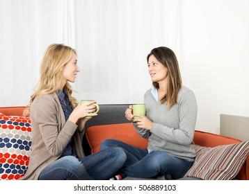 Young women relaxing on sofa