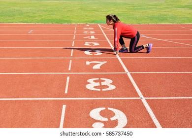 Young women running in stadium
