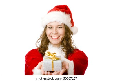 Young women in Santa Claus dress is holding a Christmas present on her ear, to find out what is inside. Isolated on white.