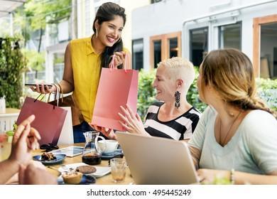 Young Women Shopping Bags Concept